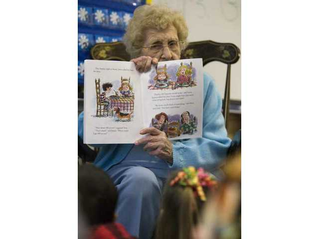 One-hundred-year-old Alhambra resident Elsie Gound reads to Theresa Aragon's kindergarten class Monday morning in celebration of the 100th day of school. Gound spoke to two kindergarten classes at Bouquet Canyon Elementary School about growing up in Iowa.