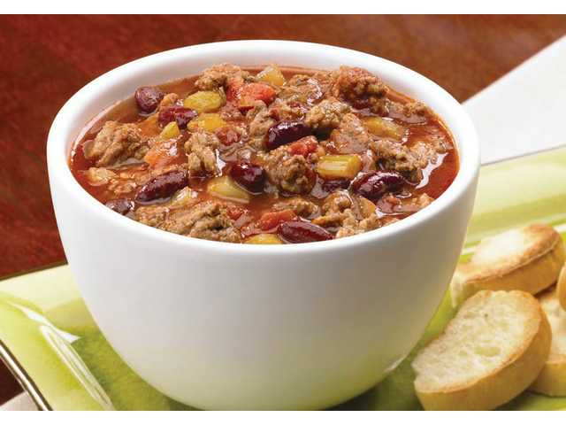 Chiliville Chili Yield: 10 to 12 servings 1 package (16 ounces) Johnsonville Italian Ground Mild, Sweet or Hot Italian Sausage (Substitute Johnsonville Mild, Sweet or Hot links by simply removing the casing)1 pound ground beef1 medium onion, chopped3 celery ribs, chopped3 garlic cloves, minced3 cans (14.5 ounces each) diced tomatoes with green peppers and onions2 cans (16 ounces each) kidney beans, rinsed and drained1 can (14.5 ounces) beef broth1 can (6 ounces) tomato paste2 tablespoons brown sugar2 tablespoons chili powder1 tablespoon Worcestershire sauce2 teaspoons ground cumin1/2 teaspoon crushed red pepper flakes Shredded cheddar cheese (optional)In large saucepan, cook sausage and ground beef over medium heat until meat is no longer pink; drain. Add onion, celery and garlic. Cook and stir for 5 minutes or until tender. Stir in tomatoes, beans, broth, tomato paste, brown sugar, chili powder, Worcestershire sauce, cumin and red pepper flakes. Bring to a boil. Reduce heat; cover and simmer for 20 minutes. Sprinkle with cheese, if you like, and serve immediately.