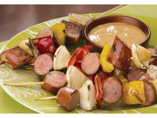 Honey Mustard Turkey Sausage SkewersYield: 8 skewers1 package (13.5 ounces) Johnsonville Smoked Turkey Sausage2 medium yellow onions2 medium sweet red and yellow bell peppers 1 bottle (12 ounces) honey mustard18 small metal or wooden skewers Cut each sausage link into six slices. Peel onion and cut into 1/2-inch pieces. Core peppers and cut into 1/2-inch pieces.Thread sausage slice, onion slice, pepper slice and second sausage slice onto metal or soaked wooden skewer.Grill skewers on charcoal or gas grill or on a grill pan over medium heat about 5 to 6 minutes. Turn and grill another 5 to 6 minutes or until vegetables are tender and sausage is hot. Brush with honey mustard; serve.