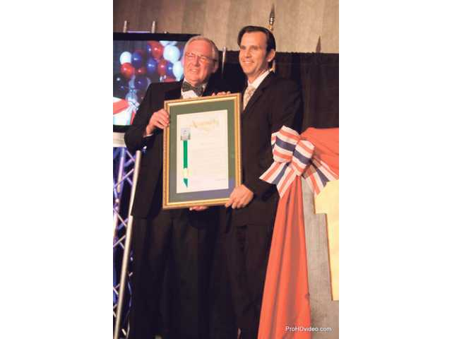 Assemblyman Cameron Smyth, R-Santa Clarita, right,  presents an award recognizing the contribution of outgoing chamber president Charlie Gill at the Santa Clarita Valley Chamber of Commerce 85th Annual Installment Dinner, Friday.