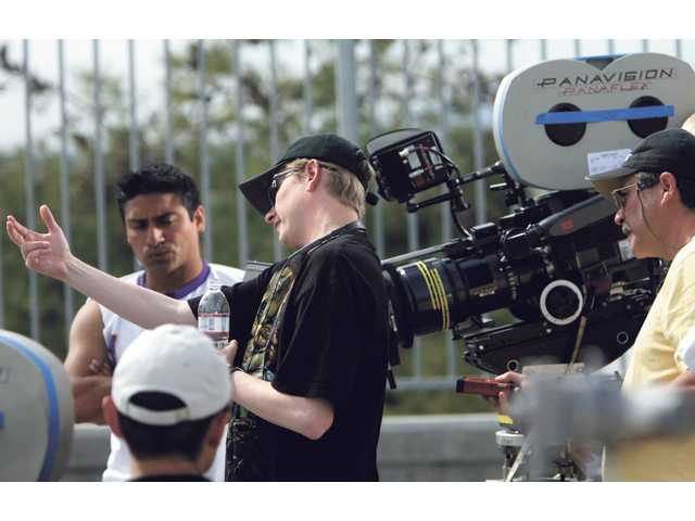 "In this undated photo, writer, producer, director and actor Ray Griggs, from Simi Valley, discusses camera angles in preparation for filming a scene from the movie, ""Super Capers,"" an indie film that was shot in the Santa Clarita Valley last year."