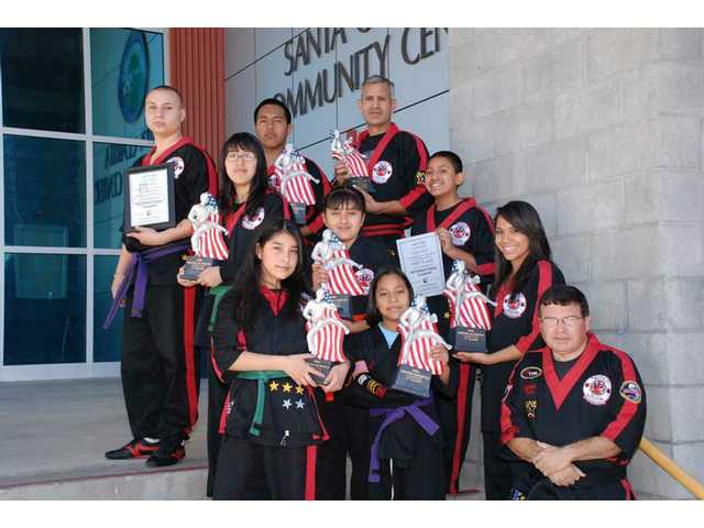 Newhall Community Center's karate team represented Santa Clarita well at the 2009 IMAC USA Martial Arts Winter Olympics in Las Vegas. Top row (from left): Mark Bradby, 21, 4th; Carlos Cazares, 17, 1st; Ruben Caldera, 45, 2nd. Middle row: Kelly Cervantes, 14, 1st; Yohana Neri, 10, 1st;  Jonathan Perez, 11, 4th. Bottom row: Yareli Cervantes, 11, 2nd; Karen Celis, 11, 1st; Jennifer Perez, 16, 1st; and Sensei Dave Moreno.