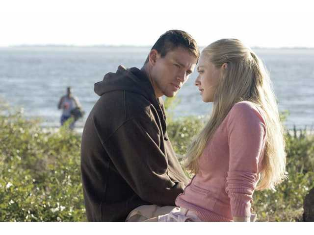 "Channing Tatum, left, and Amanda Seyfried are shown in a scene from ""Dear John,"" which opens locally this week. In this movie, the resulting ""Dear John Letter"" is just good common sense."