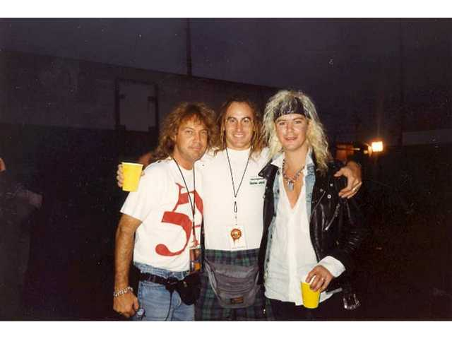 In this undated photo, Craig Duswalt, left, Axl  Rose's chiropractor, center, and Duff McKagan pose for a photo during Duswalt's stint as personal manager for Axl Rose.