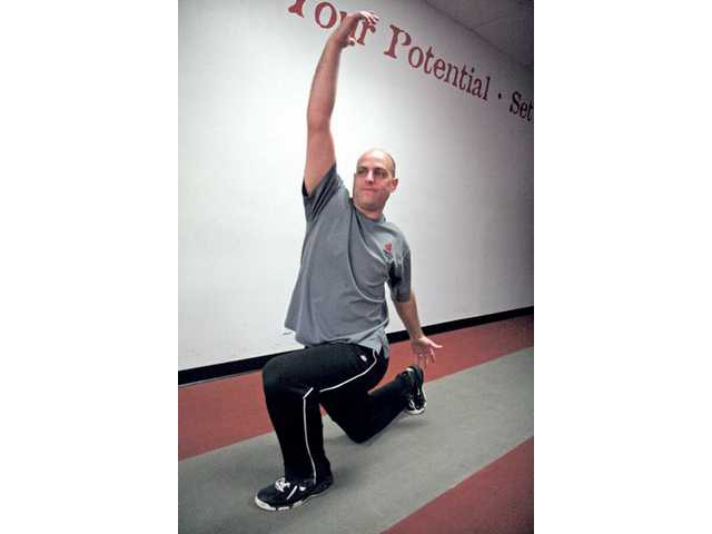 Craig Rasmussen performs a Reverse Lunge with Twist and Reach.