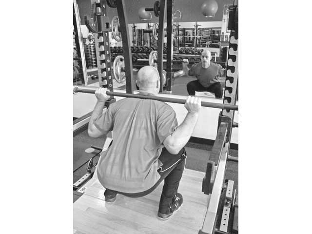 Squats are part of the winter sports exercise routine created by Rasmussen.