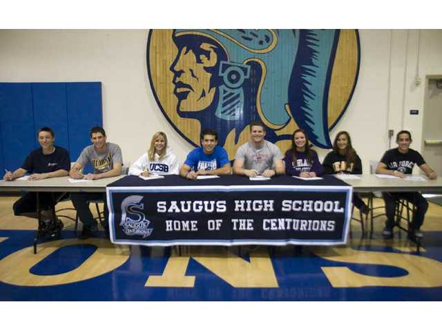 (Right, from left to right) Saugus High athletes Zachary Vincej, Kyle Hooper, Erin Ortega, Desi Rodriguez, Daniel Swarbrick, Ashley Kramer, Shannon Suarez and Travis Langham pose at Saugus Wednesday.