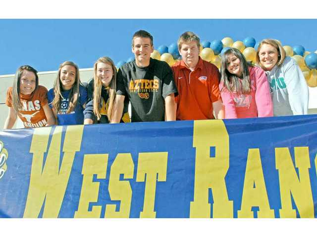 (Left, from left to right) West Ranch High athletes Erin Child, Taylor Greasley, Holly Hein, Jake Bernards, Robert Waterman, Emma Rice and Katie Kessler pose at West Ranch High on National Signing Day.