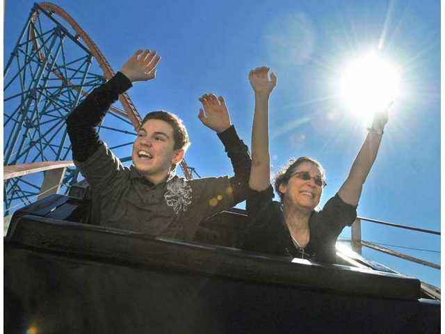 Josh Malone, 13, and his mother Jodi Malone, go hands-free aboard Colossus at Six Flags Magic Mountain. They are true roller-coaster fanatics. He has ridden nearly 200 different roller-coasters in his lifetime, and she has ridden 457. The Malone family even takes roller-coaster vacations. With Six Flags Magic Mountain so near their Valencia home, they often get out to the park to to experience some of their favorite rides. They know just where to sit on each one.