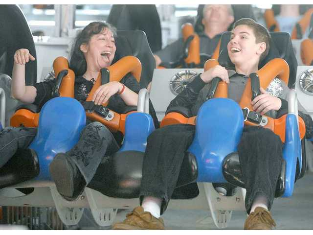Jodi Malone and her son Josh Malone on X2 at Six Flags Magic Mountain.