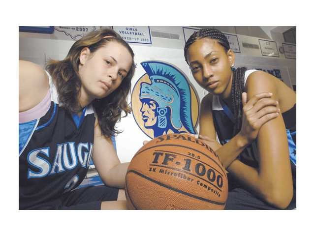 Saugus seniors Gabrielle Conn, left, and Nicole Hicks, right, have led the Centurions to the top of the Foothill League girls basketball standings. They have done so with record-breaking performances.