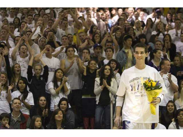Valencia senior David Stroud gets a standing ovation during Senior Night before Friday's game against West Ranch at Valencia High School. Stroud was diagnosed with stage IV Hodgkin's Lymphoma on April 23 and suffered from septic shock four months after being diagnosed, but he is recovering and made a layup at the beginning of the game Friday thanks to an agreement between the two schools.