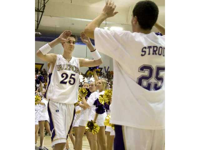 Valencia senior David Stroud (25) high-fives a teammate as he is announced as a starter before Friday's game against West Ranch. Thanks to an agreement between the two schools, Stroud scored his team's first basket.