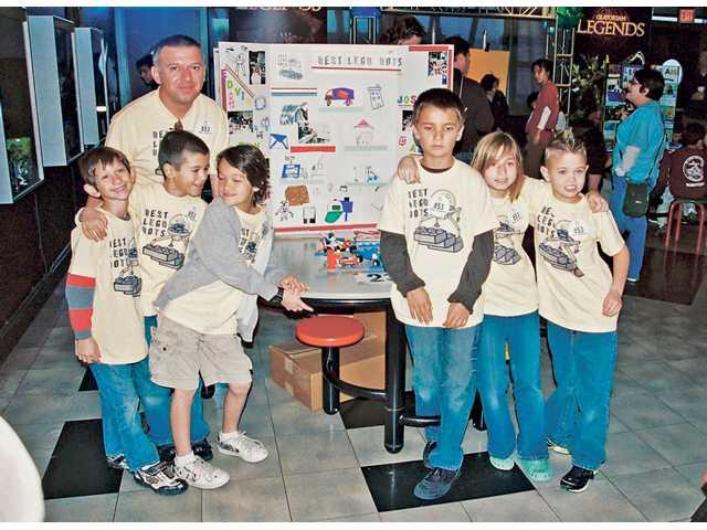 The Best Legobots team, left to right, Connor Raskin, Edvin Kuric, Alec Griffin, Ben Allen, Jacquelyn Krieger, Joshua Morrill and Coach Amer Kuric.