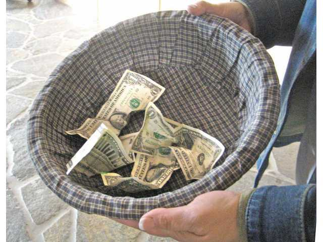 Church leaders said congregations remain faithful to giving each week however they can, but a troubled economy  has led to decreased funds in collection baskets, like the one pictured above. Congregation leaders are also being forced  to re-evaluate operating budgets due to the increased need for help.