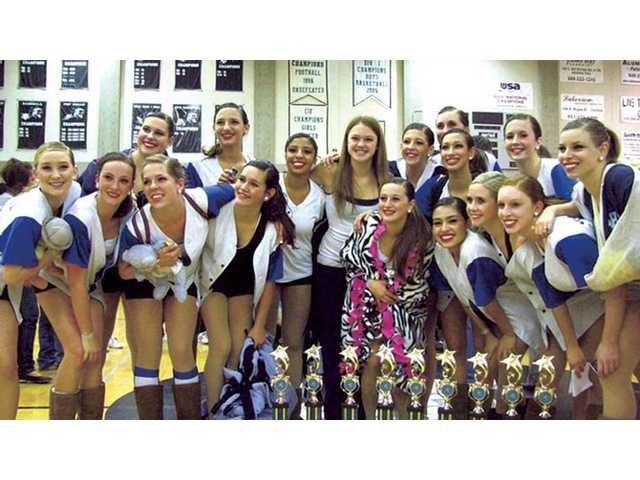 The Saugus High School Dance Team proudly displays trophies won at the Aliso Niguel Classic held Jan. 24 in Aliso Viejo.