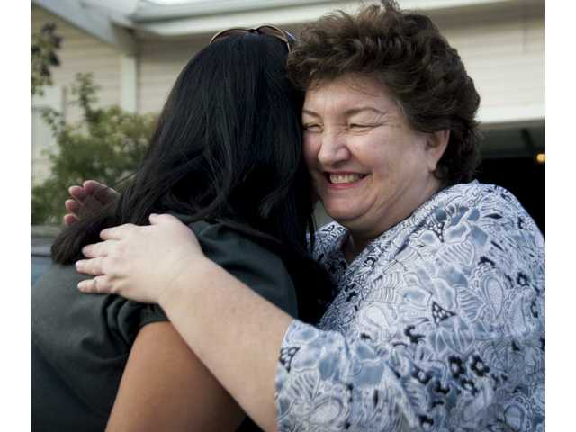 Debbie Quick, right, of Santa Clarita Valley Single Mothers receives a hug from Juanita Ramirez, a local single mother whom she has been helping for seven years. The current economy finds many single mothers in need of help.