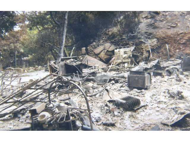 Terry Herdliska's cabin in the Angeles National Forest, now a pile of ash and rubble after the 2007 Buckweed Fire , was supposed to be his retirement home. He lives in a mobile home now, waiting for a check from the Federal Emergency Management Agency.