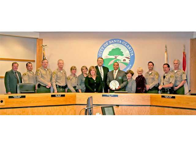 The Santa Clarita City Council honored Santa Clarita Valley Sheriff's Station Captain Anthony La Berge (center, with plaque) and station deputies for helping to make the city one of the safest in the nation.