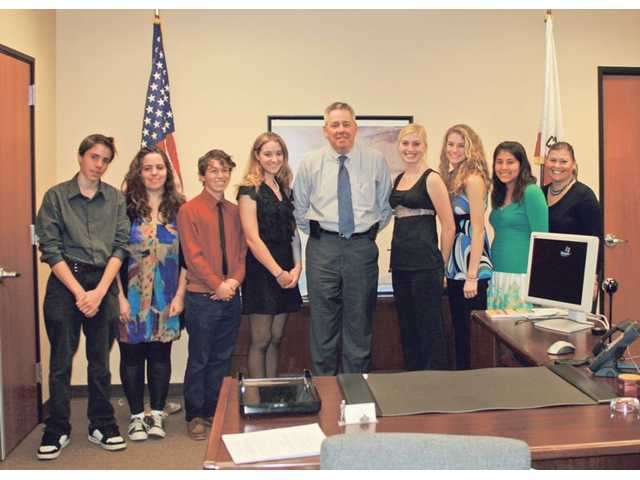 "From left to right, Student Task Force members from Canyon and Valencia high schools Laurent Abergel, Audrey Abergel, Kristopher Kaufman, Megan Scherich, Bob Haueter, deputy chief of staff for Congressman Howard ""Buck"" McKeon, R-Santa Clarita, Ruby Lawler, Mariah Mahotz, Amy Lopez and Student Task Force Adviser Nancy Medina."