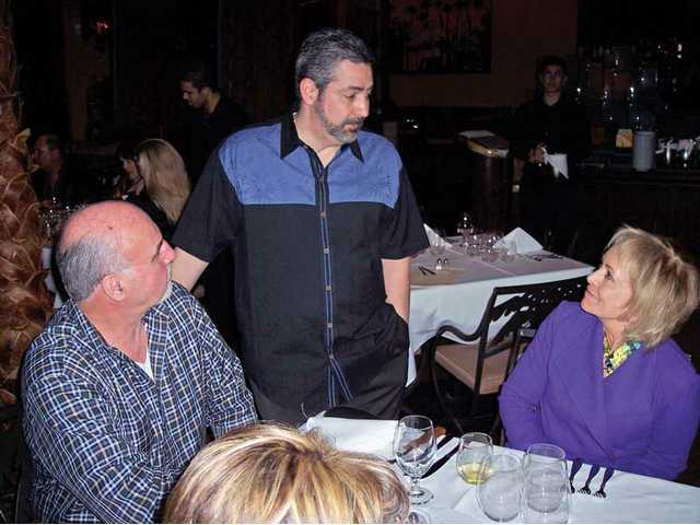 Rolando Verdecia of Mojito Cuban Cuisine visits with wine dinner guests.