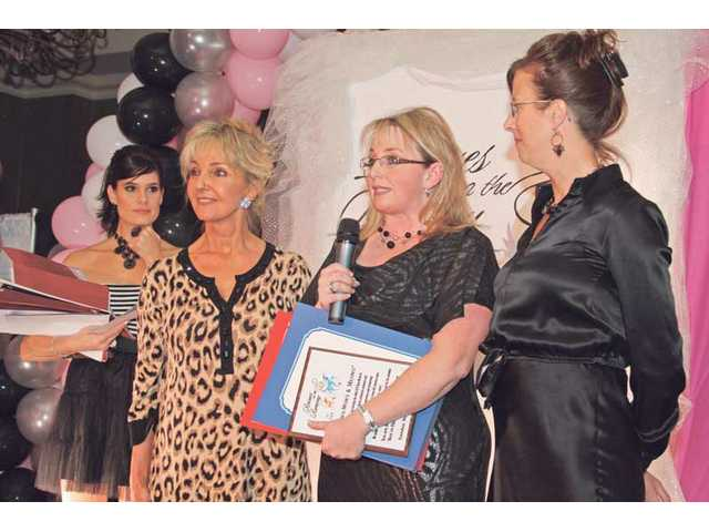 Left to right, Tiffany Michelle, Mardi Rivetti, Yvonne Allbee and Michelle Sathe on stage at Rescues on the Runway. Allbee and Sathe acccepted an award on behalf of Bow-Wows & Meows.