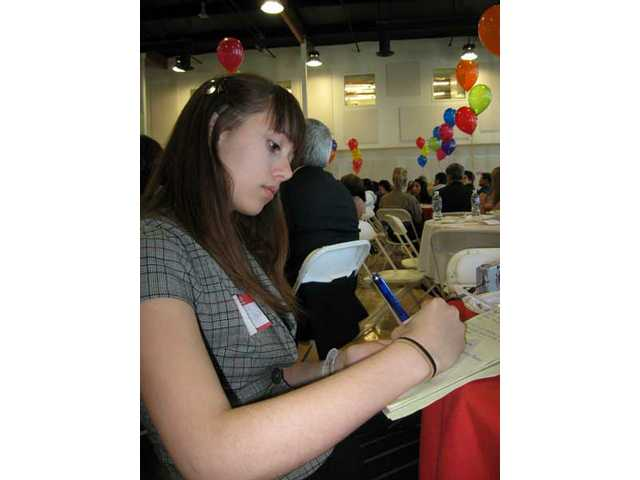 Yvonne Eadon, a Hart High School junior, takes notes during an orientation at the Groundhog Job Shadow Day luncheon Feb. 4. Eadon shadowed Pat Willett, a public relations specialist. Students received the opportunity to follow around professionals in various fields to learn how local industry operates.