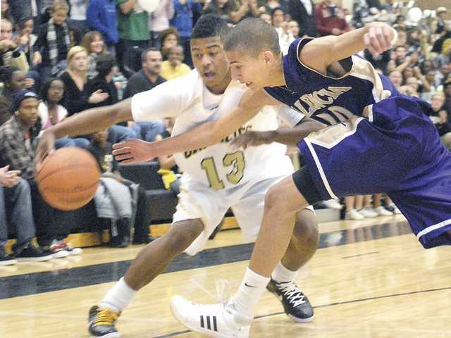 Golden Valley's Maverick Ahanmisi (13) dribbles as Valencia's Lonnie Jackson attempts a steal Tuesday. Both players scored 29 points.