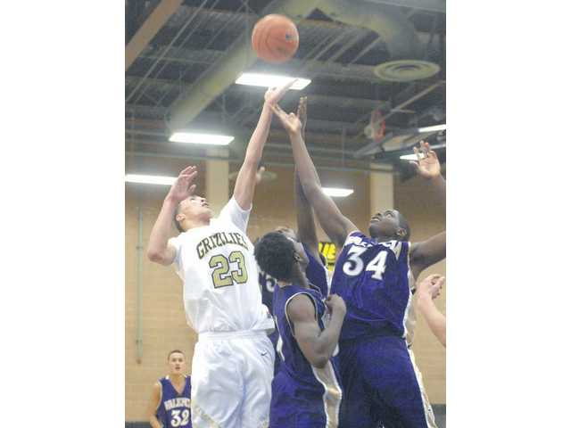 Golden Valley High junior Trevor Wiseman (23) and Valencia's Kevin Rush (34) go up for a rebound Tuesday at Golden Valley High. Wiseman scored 17 points in the game.