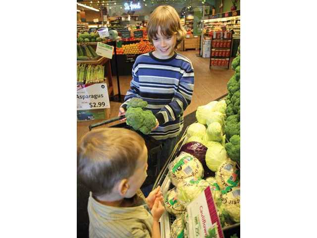 Ten year-old Christopher De Sesa and brother Nico De Sesa, 4, shop for their favorite healthy foods at the Whole Foods Market in Valencia.