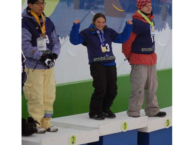 Marisa Watkins of Valencia (center) scored a gold medal at the Special Olympics Winter World Games in Sun Valley, Idaho on Friday in the Snowboarding Intermediate Giant Slalom, edging Suk Il Huang of South Korea (left) and Martin John of the Czech Republic (right).