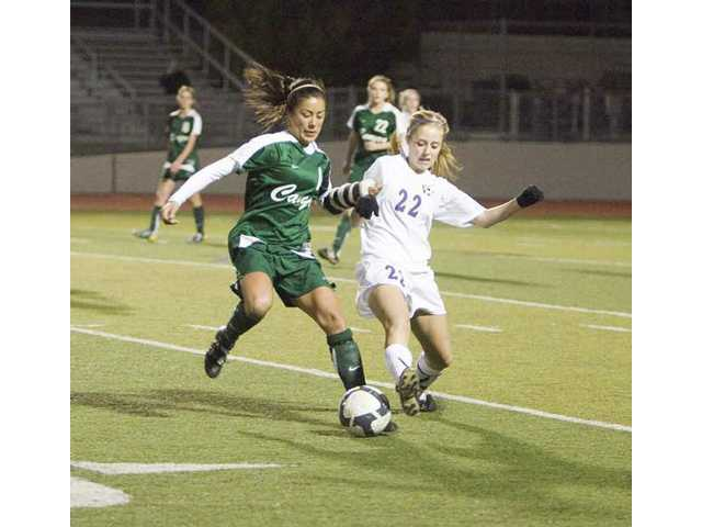 Canyon's Nichole Guerrero, left, and Valencia's Sarah Tuffey battle to get control of the ball Thursday at Valencia High. The game ended in a 0-0 tie.