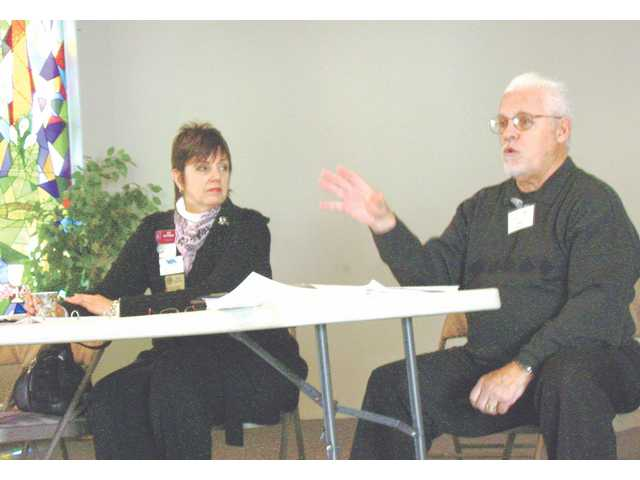 Sue Reynolds, senior partner of NewMarket Careers and Tom Royston, a Valencia United Methodist WOW volunteer and technical recruiting specialist, instruct a small group on the importance of networking for job seeking. Workshop attendees could attend a number of groups based on topics such as resume buildings, interview skills, executing a job search, Internet research and more.