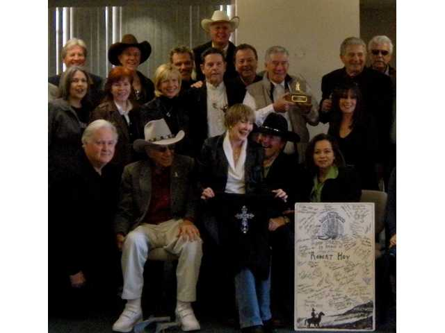 "More than 60 Western actors, stuntmen and friends packed the penthouse at Northridge Hospital to present the Golden Boot award to Robert F. ""Bobby"" Hoy Jan. 28. Hoy, gravely ill, is not pictured. He died Feb. 8."