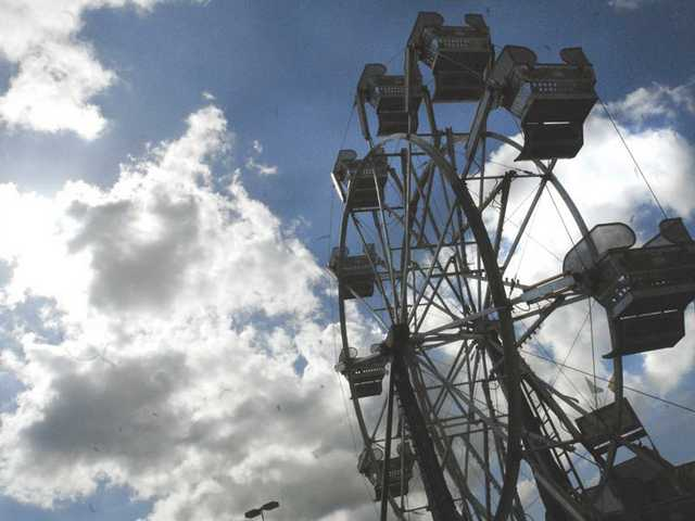 Clouds drift over the Christiansen Amusements carnival at Westfield Valencia Town Center Saturday afternoon.
