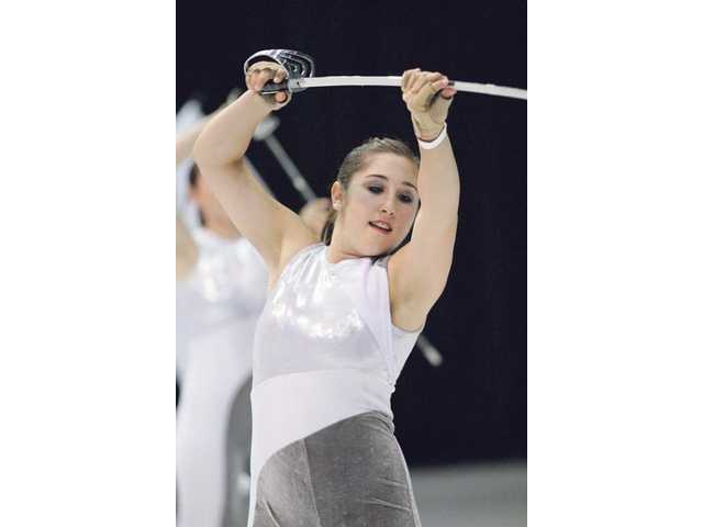 Katie Fundora practices with Valencia High School's Colorguard, which hopes to raise $15,000 — enough to take the team to the World Championships in Ohio in April.