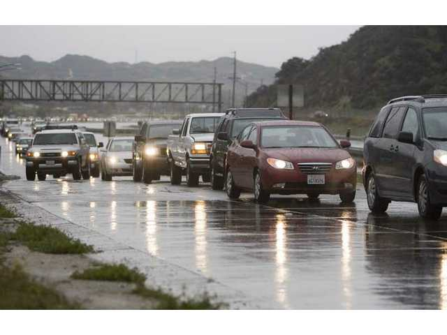 Cars pile up before exiting at Parker Road in Castaic, Monday morning. Road closures prevented anyone from traveling northbound on Interstate 5.