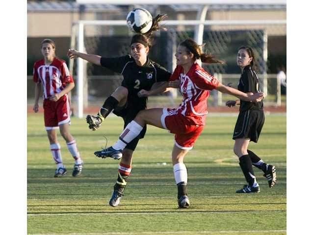 Valencia's Alyssa Triana (2) and Kelsey Steck (19) battle for the soccer ball Feb. 3 at Hart High School. Both teams made the CIF-SS playoffs.