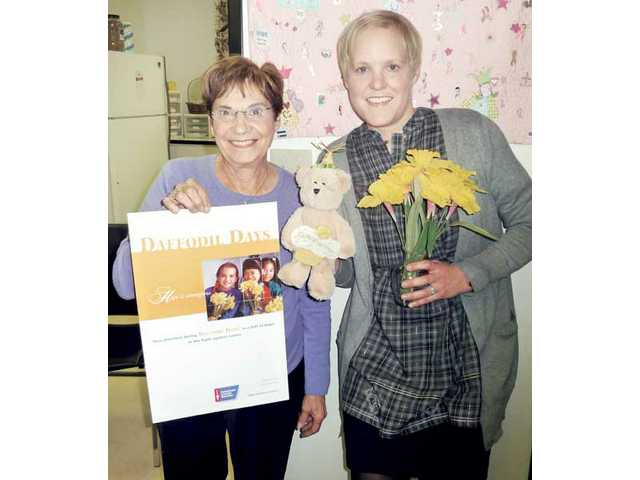 Agnes Russell, left, and Heather Warrick display bears and daffodils that are available during the 2010 Daffodil Days campaign running through March 1 in the Santa Clarita Valley to benefit the American Cancer Society.
