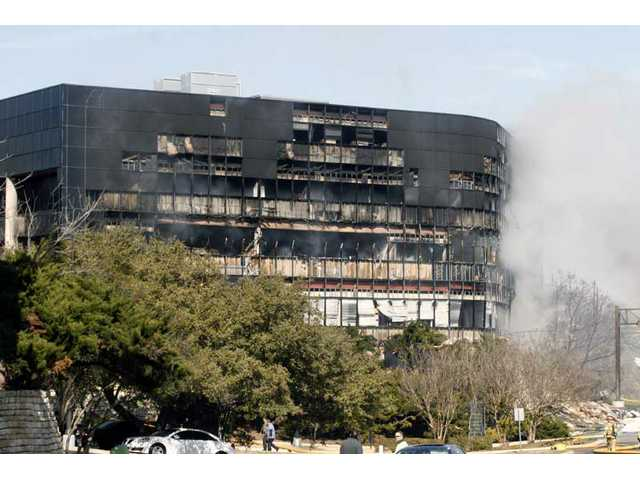 Smoke billows from a seven-story building after a small private plane crashed into the building in Austin, Texas on Thursday, Feb. 18, 2010.