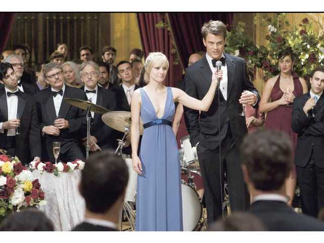 "Josh Duhamel, right, and Kristen Bell are shown in a scene from, ""When in Rome."" It rated one and a half stars."