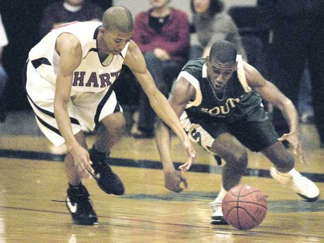 Hart's Ben Kimble, left, goes for the ball against South Torrance's Lateef Smith Wednesday at Hart High.