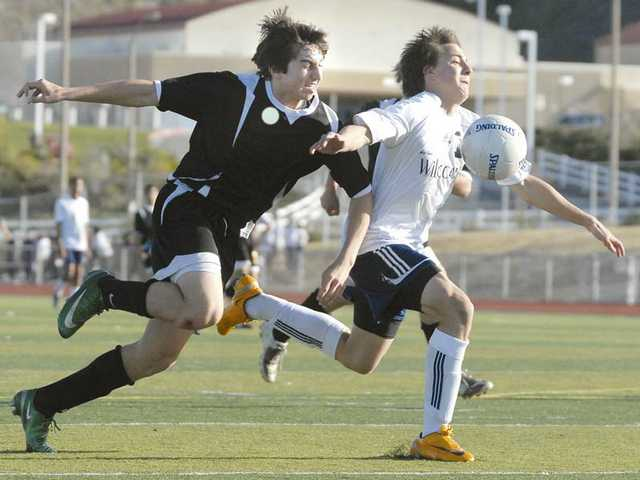 West Ranch's Jacob Jordan, right, tries to gain control of the soccer ball in front of a Cabrillo High defender at West Ranch High in the wild card round of the CIF-SS Div. III playoffs.