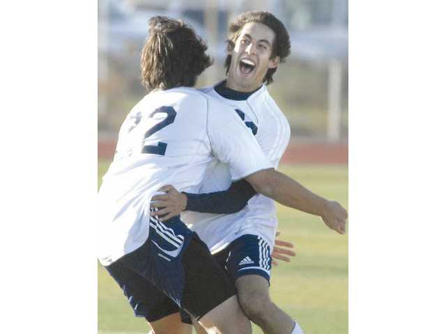 West Ranch's Pablo Morales (22) hugs teammate Sergio Torres after Torres' goal in the second half.