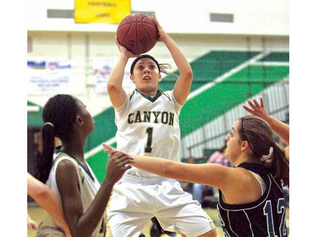 Canyon's Brooke Lemar (1) pulls up for a shot on Thursday at Canyon High in the first round of the CIF-Southern Section Division IIAA playoffs.