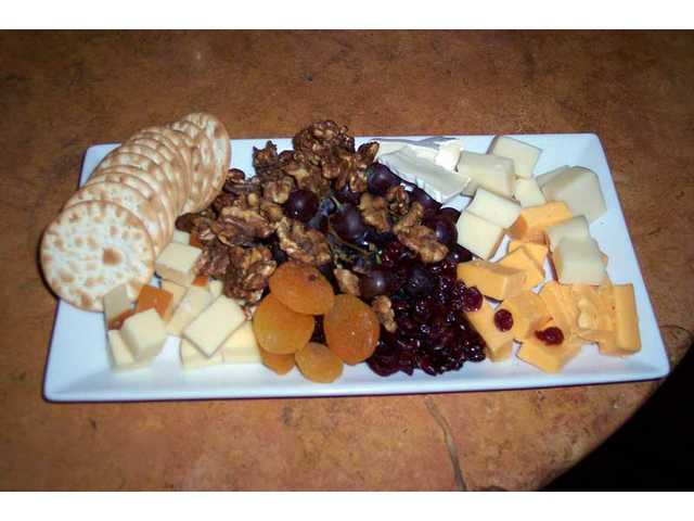 The fruit and cheese plate appetizer at All Corked Up ($13) includes a large plate of selected cheeses and assorted dried fruit - including apricots, cranberries, candied walnuts and grapes.
