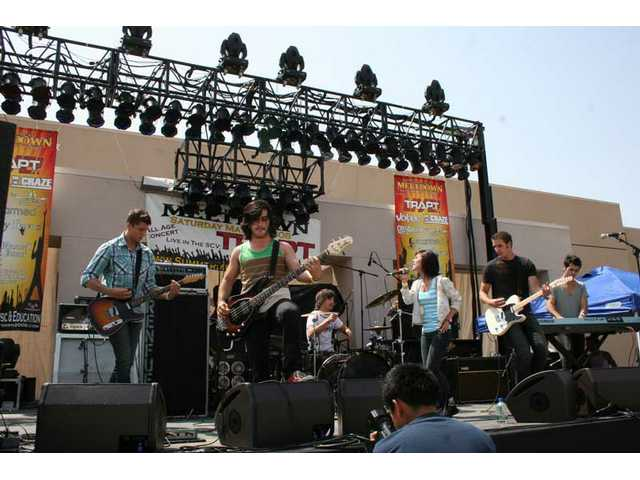 Renfue performs at Yes I Can's Summer Meltdown concert at Golden Valley High School last May.