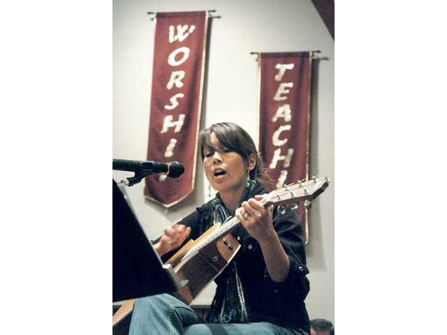 "Ligaya Kelly of Canyon Country plays and sings ""Don't Talk"" by Natalie Merchant at Hope-N-Mic, a free family-friendly open microphone event that was held on Thursday night."