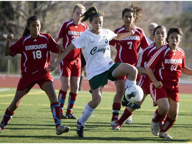 Surrounded by a group of Burroughs soccer players, Canyon's Jessica Gatton (3) dribbles the ball forward Thursday at Canyon High School.