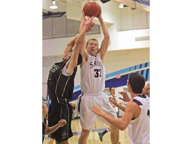 Saugus' Joey Fredrick (32) outrebounds Sunny Hills' Kevin Poli, left, Friday at Saugus High.